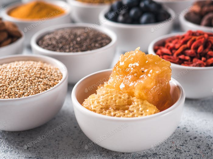 honeycomb in small white bowl and other superfoods