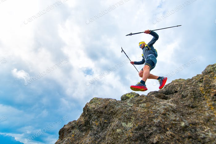 Male athlete falls from rocky ledges