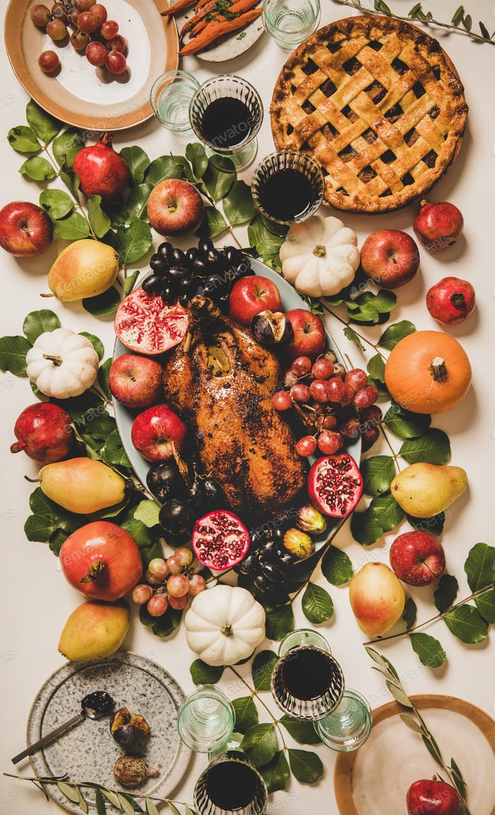 Thanksgiving celebration dinner table with roasted duck and seasonal fruits