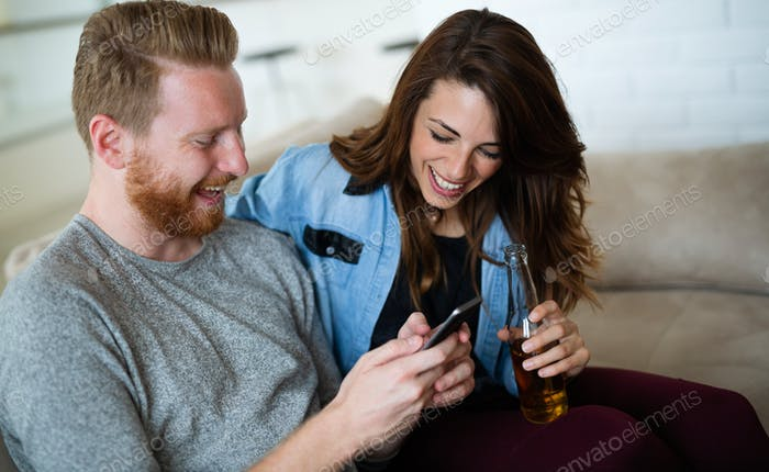 Happy couple relaxing and spending time together at home