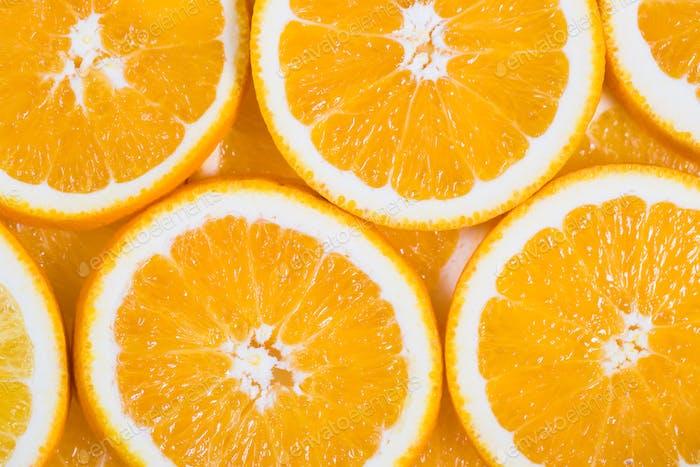 Sliced orange background. Food and drink