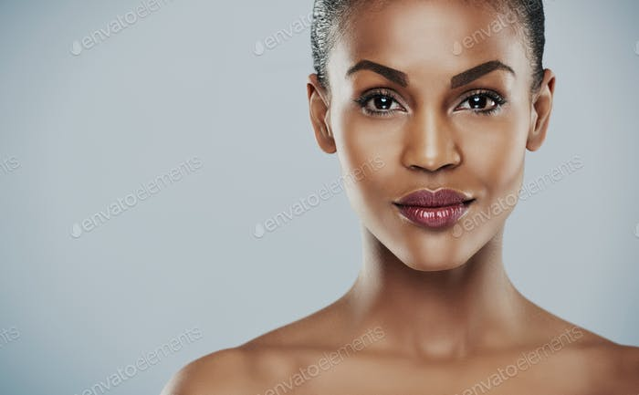 Close up of gorgeous woman over gray background