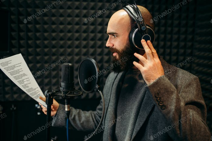 Male singer songs in audio recording studio
