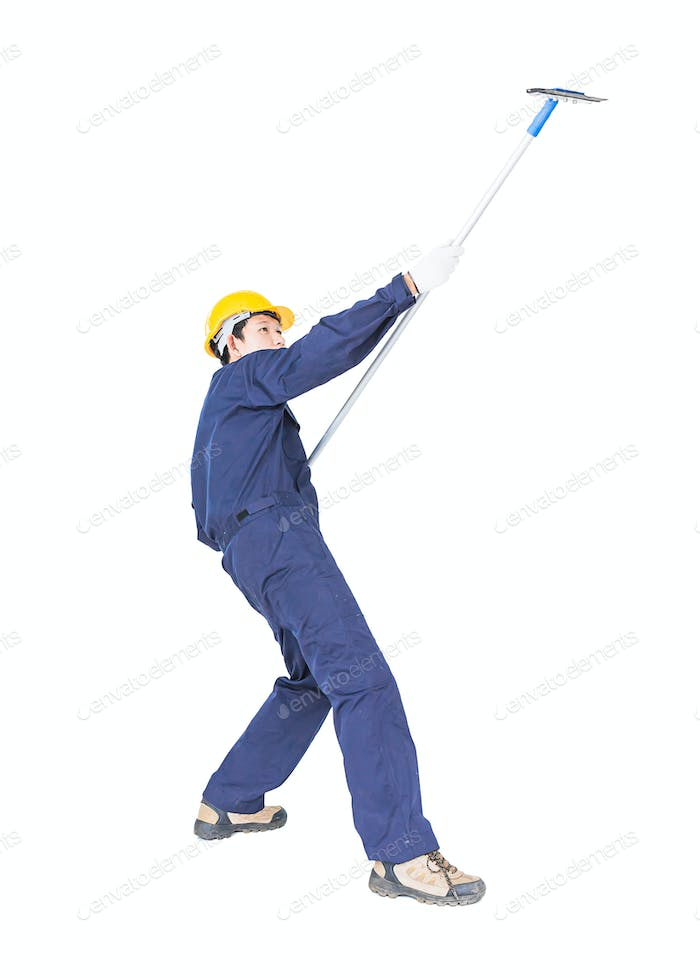 Man in uniform hold mop for cleaning glass window with clipping path 1