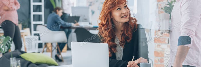 Businesswoman using laptop in coworking office