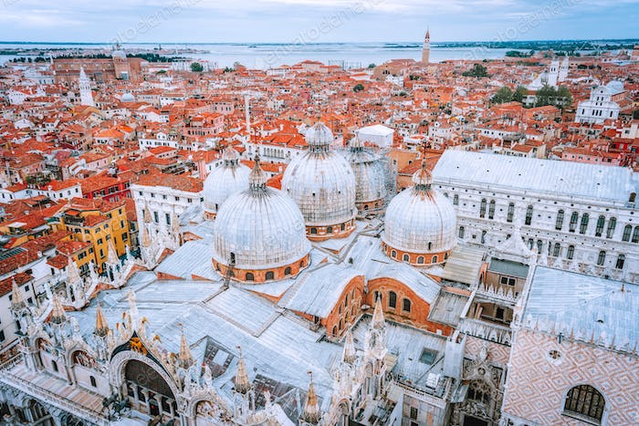 Venezia red roofs and Basilica di San Marco Cathedral at Piazza San Marco Square. Italy. Europe