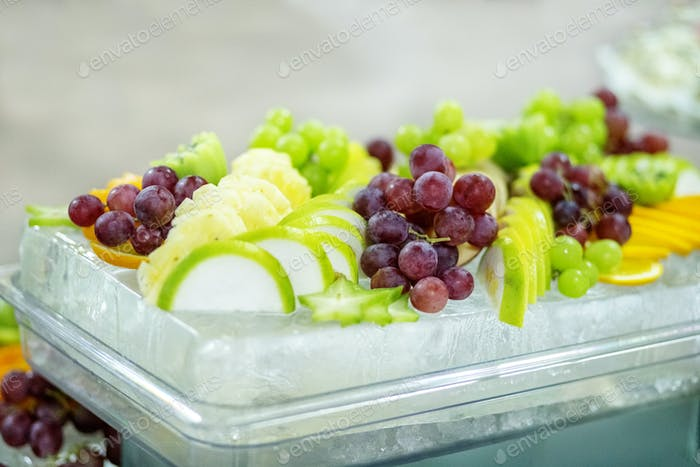 A mix of useful fruits of grapes, apples, grapes, oranges. The c