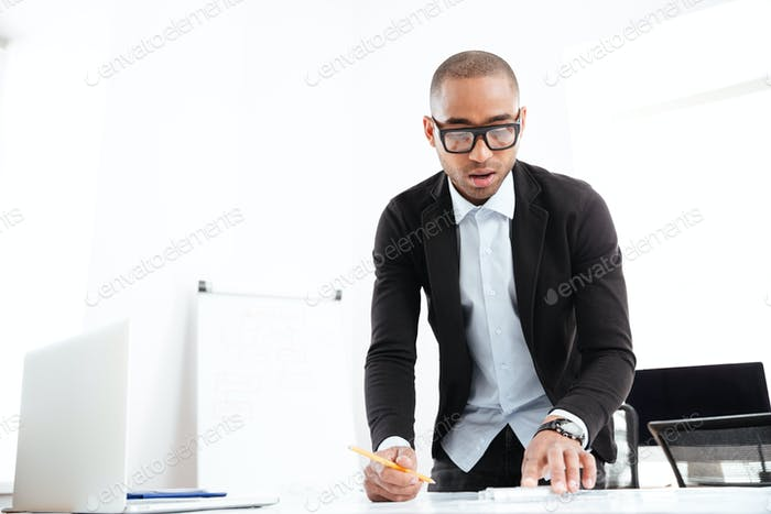Businessman working watching statistics in a paper document