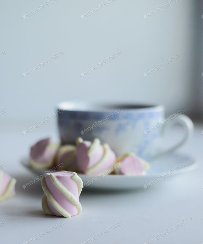 tenderness concept, marshmallow and hot cup of red tea