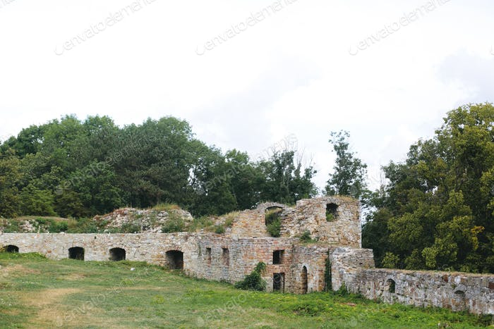 Old ruin brick walls of medieval castle, historical defence fortress in Europe