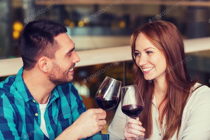 happy couple dining and drink wine at restaurant