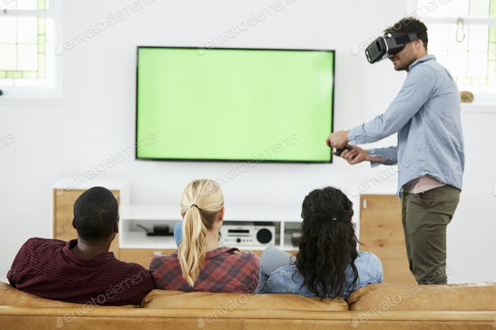 Friends Playing Computer Game With Virtual Reality Headset