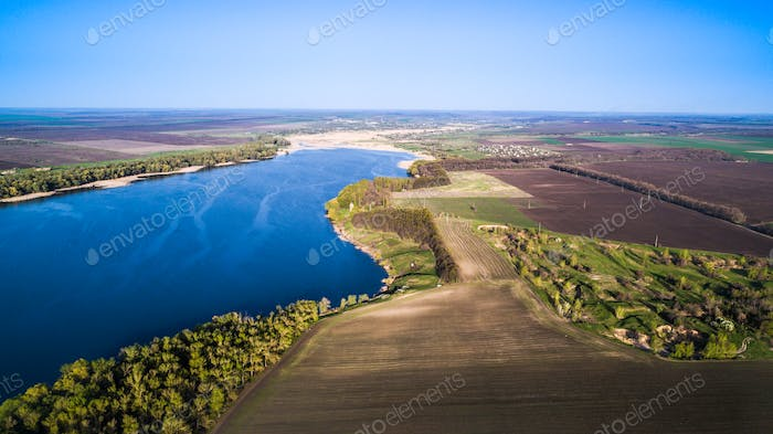 Flying over the beautiful spring river. Aerial camera shot. Ukraine