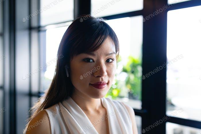Asian woman wearing wireless headphone