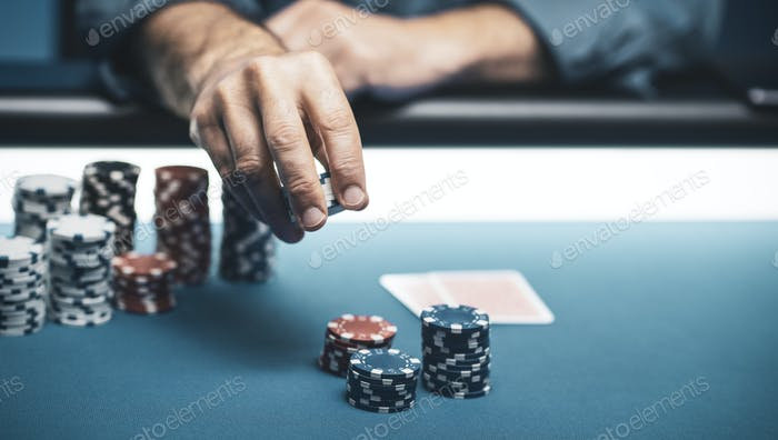 Successful player betting chips at casino