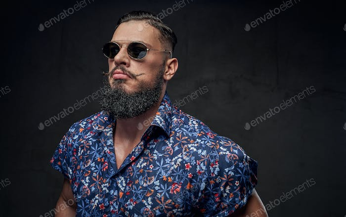 Looking like boss guy posing in sunglasses in gray background