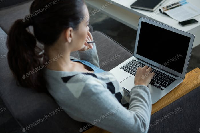 Female business executive using laptop