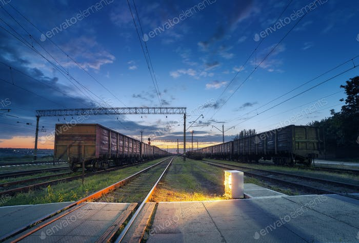 Cargo train platform at night. Railroad in Ukraine. Railway stat