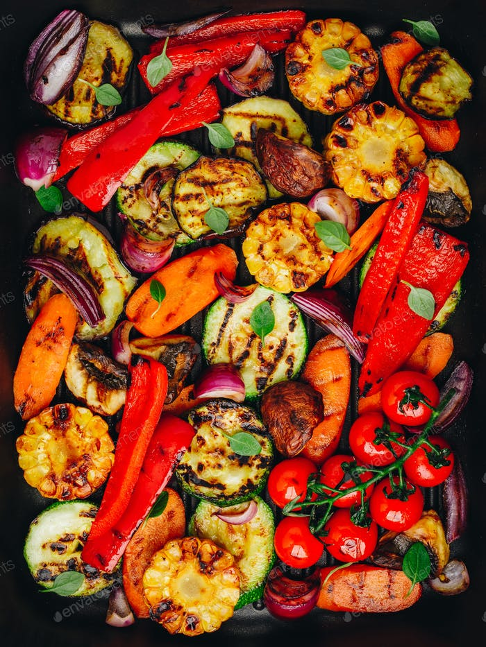Grilled vegetables in a cast iron pan.