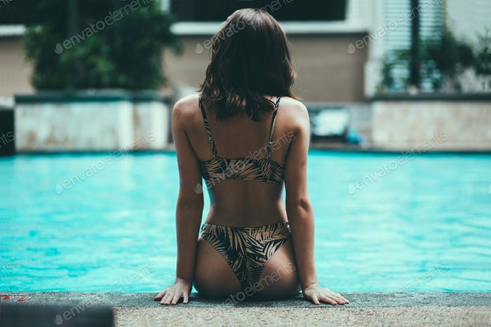 woman with stunning body near pool