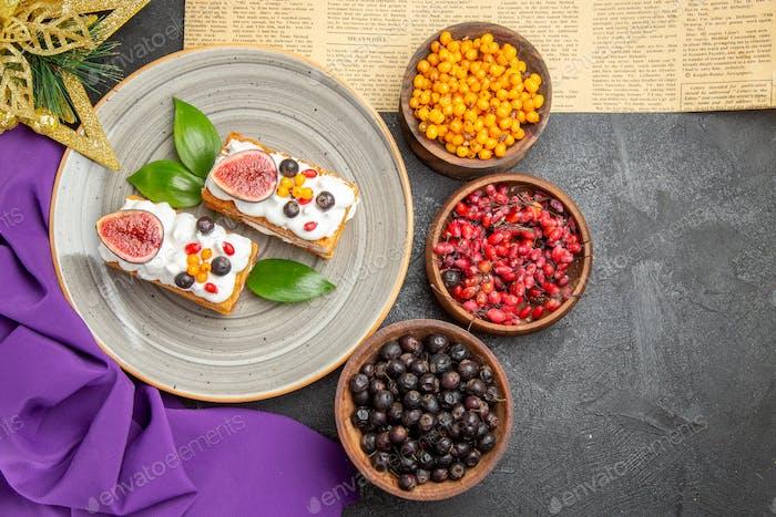 top view yummy waffle cakes with fresh fruits on dark desk sweet cake photo cream dessert