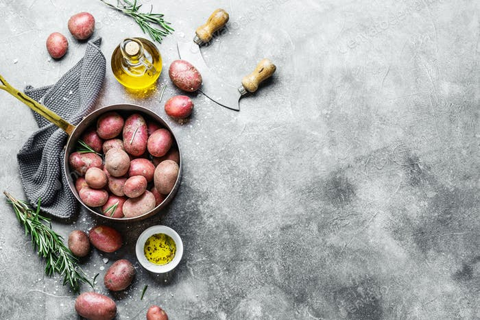 Thumbnail for Raw organic potatoes with spices on grey background