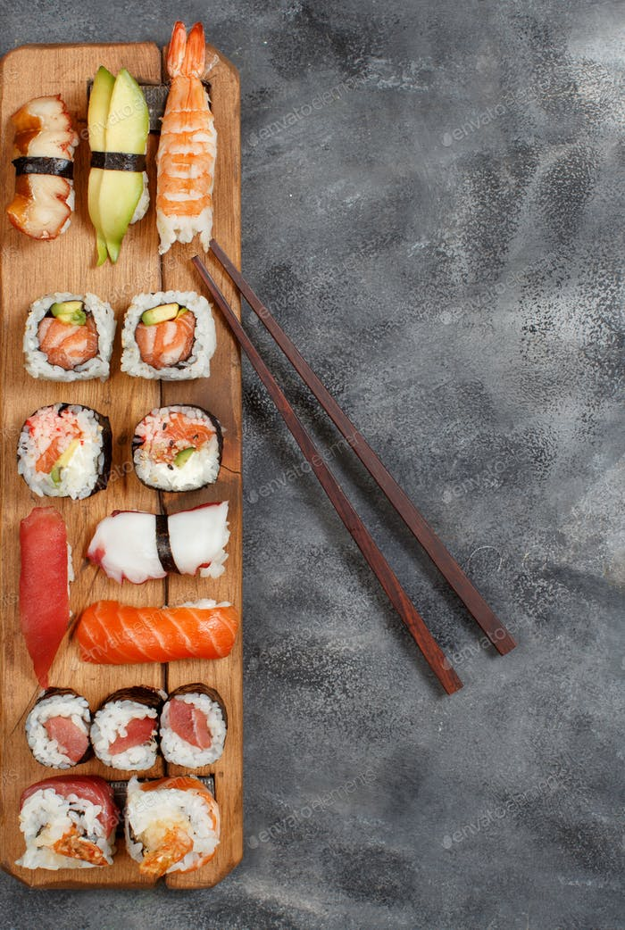 Sushi Set nigiri and sushi rolls on wooden plate