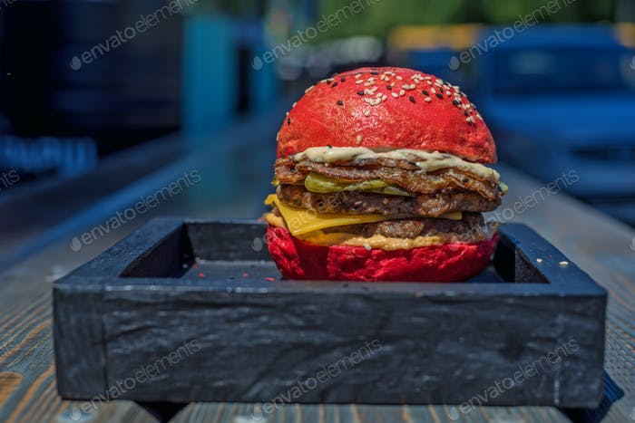 Homemade hamburger with red bun