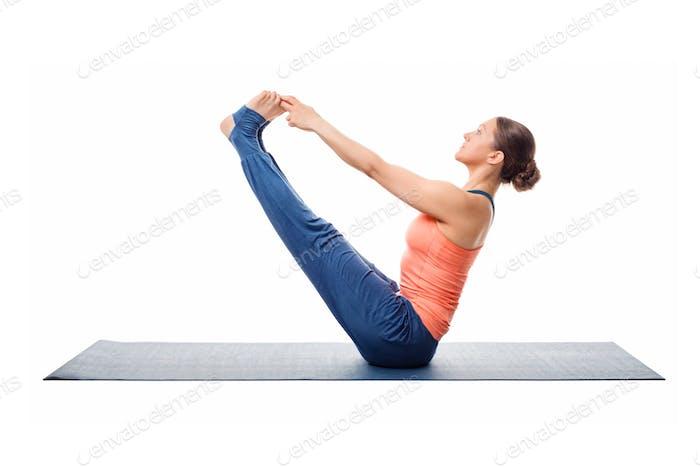 Beautiful sporty fit woman practices yoga asana