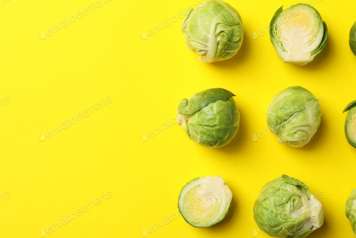 Flat lay with brussels sprout on yellow background, top view