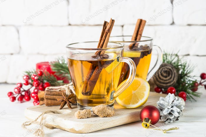 Christmas hot tea with lemon, spices and decorations