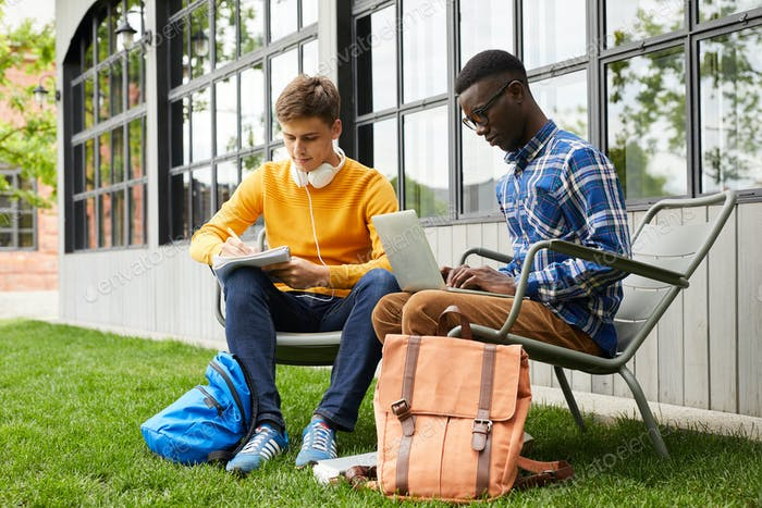 Two College Students Working Outdoors