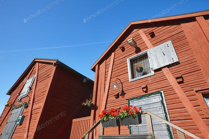 Red wooden houses in Oulu city center. Finland highlight destination