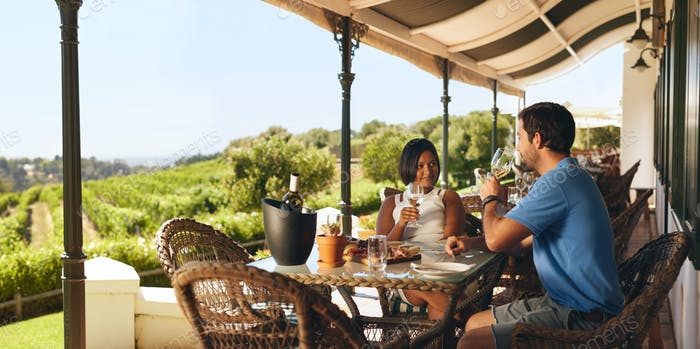 Couple enjoying a glass of wine in a winery restaurant