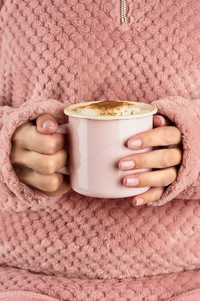 hands holding cup of chocolate, pink home cozy jacket, beautiful
