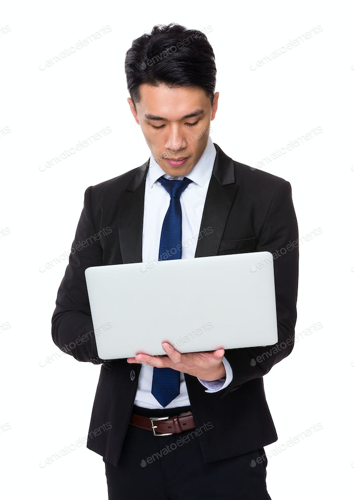 Young businessman use of laptop computer