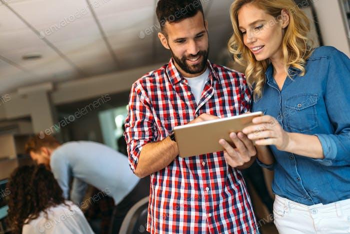 Portrait of software engineers using digital tablet