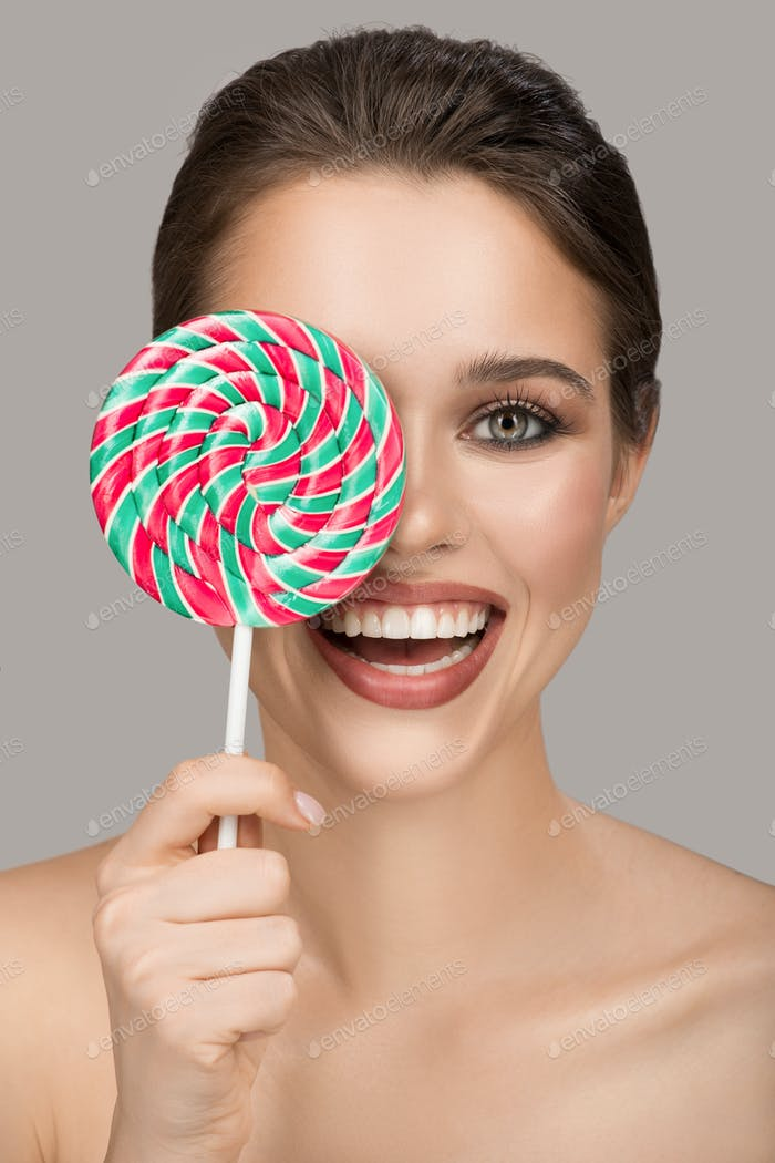 Cheerful Smiling Woman With Big Colorful Lollipop.