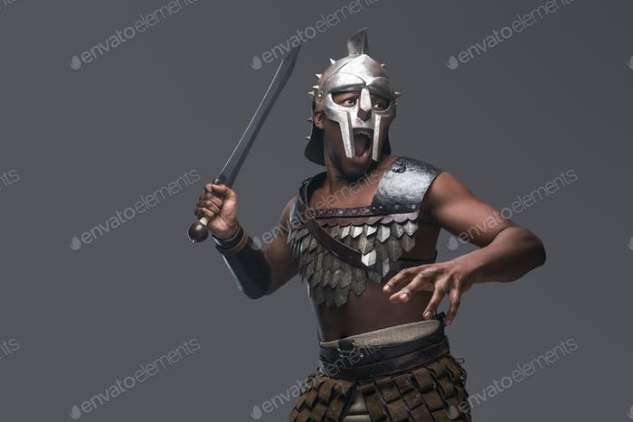 Violent gladiator with sword against gray background