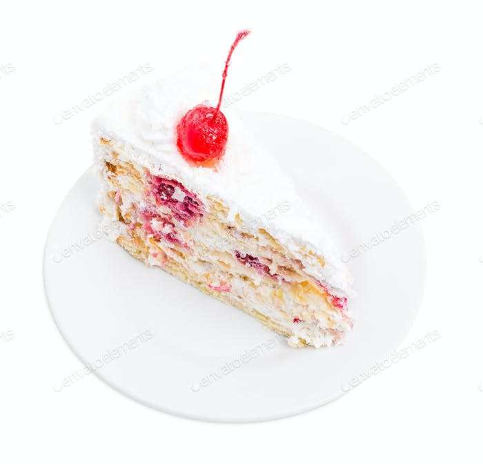 Delicious cake with cocktail cherry and coconuts.