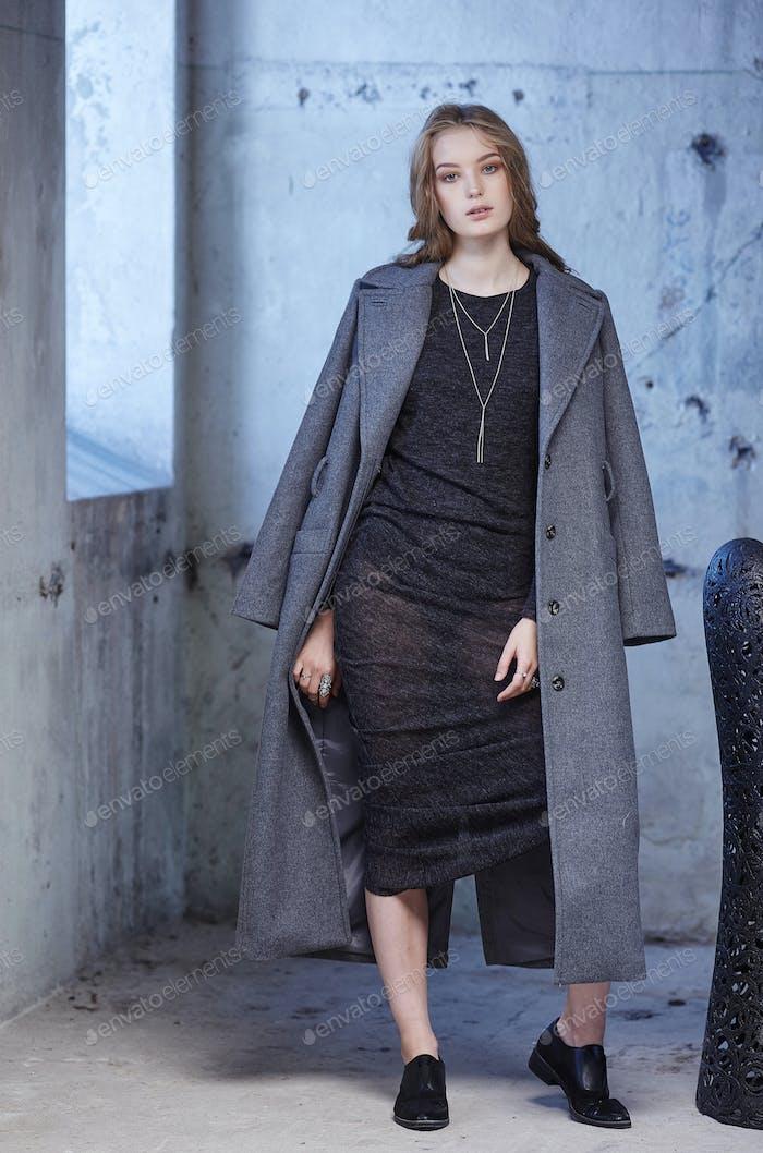 A woman in a grey coat.
