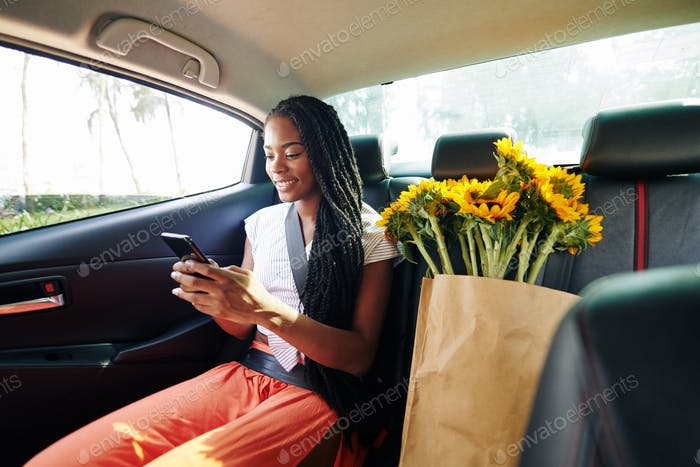 Woman riding in taxi