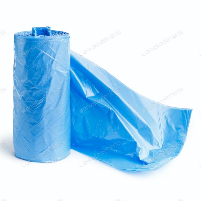 Blue garbage bags on white background