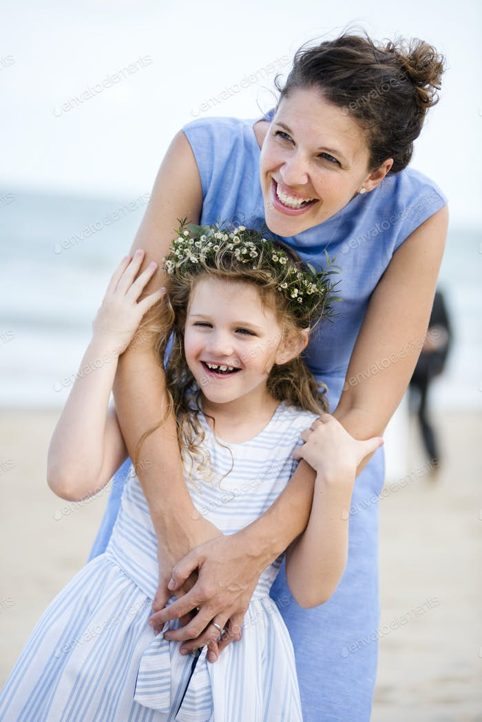 Mother and daughter at beach wedding