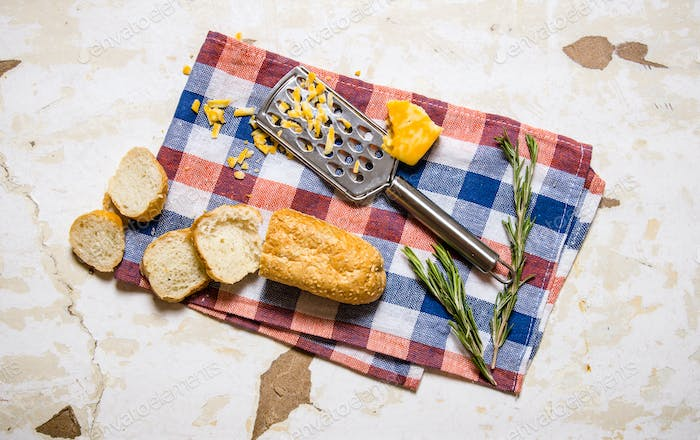 Ciabatta with cheese and rosemary on the fabric.