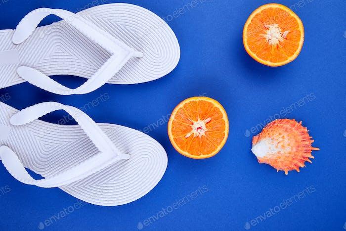 White Flip flops, Orange fruit, seashell