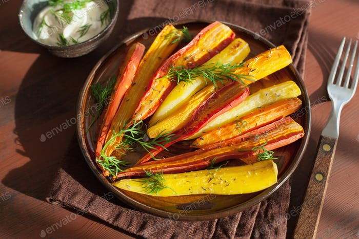 roasted colorful carrots on plate