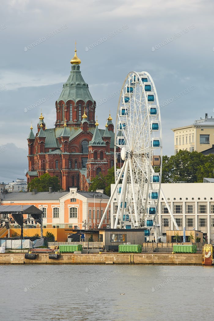 Helsinki skyline with harbor, wheel and Uspenki cathedral. Travel Finland