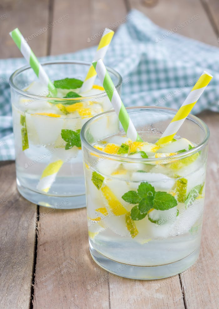 Summer cocktail from melon, mint and soda drink in the glass