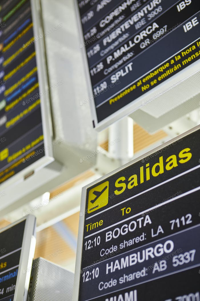 Airport flight departures info display on spanish language. Vertical